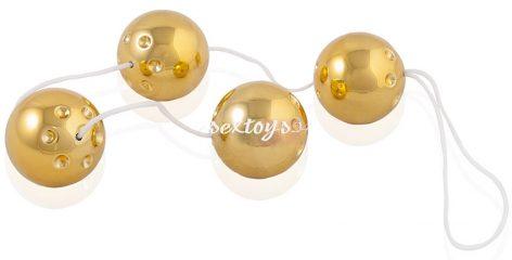 Cztery wibrujące złote kulki
